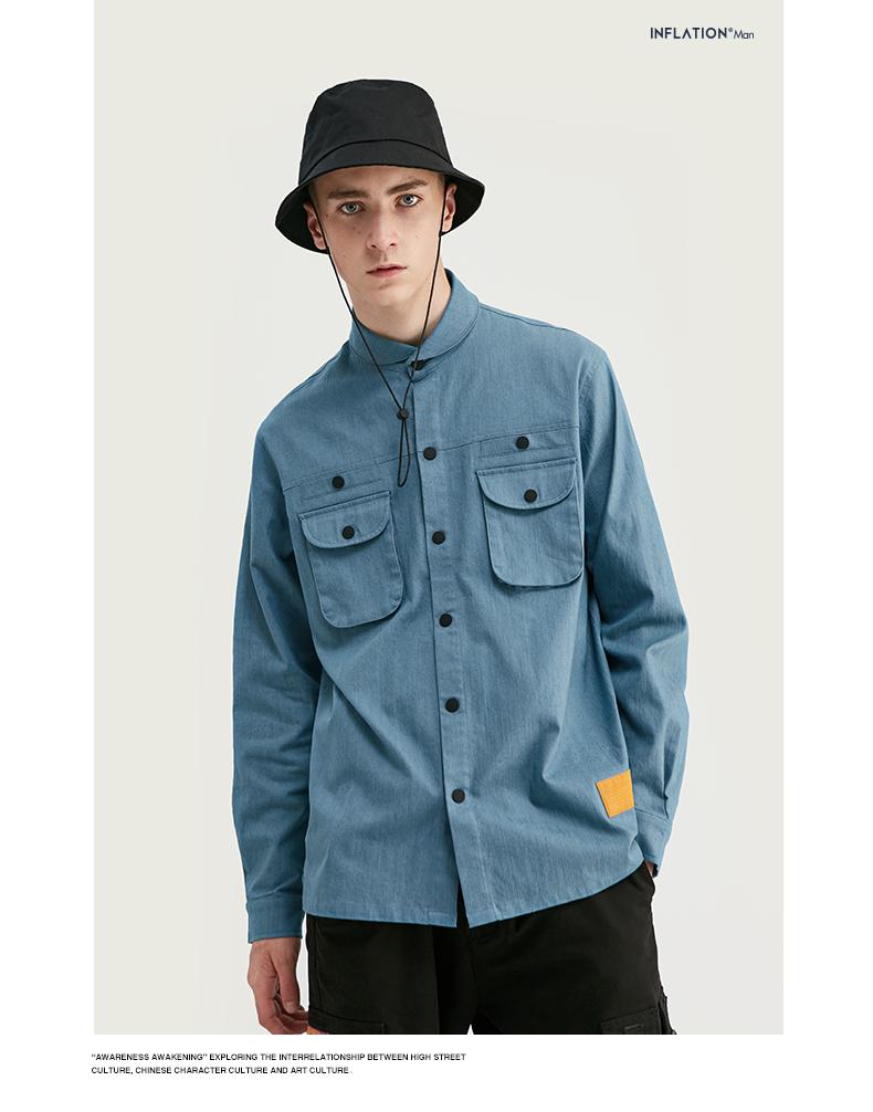 青いシャツを着た男性
